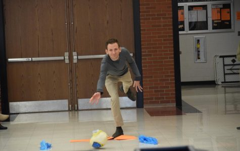 Mr. Patterson sends the turkey across the cafeteria as he bowls on the winning team.