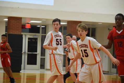 Basketball team takes on Heritage Middle School