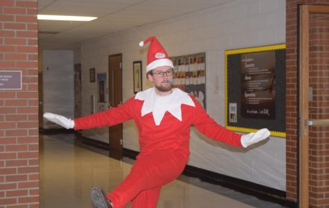 Mr. Dobeck greets students in his costume.